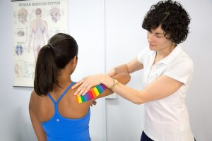 Physiotherapist applying rocktape | Stafford Physiotherapy Centre